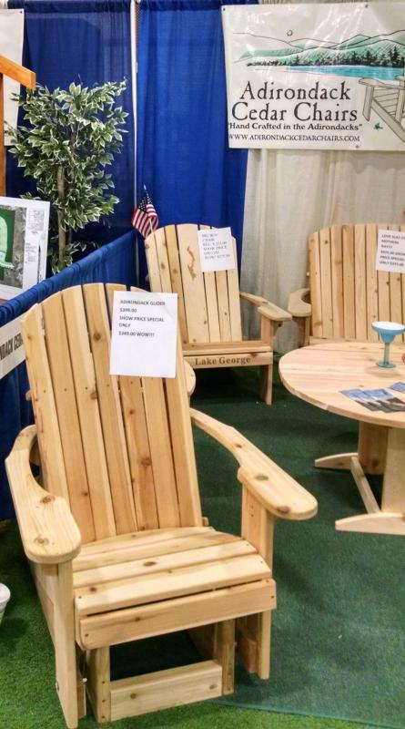 Click to enlarge image Adirondack Glider in our Show booth. The Lake George chair and a love seat can be seen in the background behind the round table. All models are available online and for pickup at our shop. - Come Visit Our Booth at Any of the Shows we Attend! -